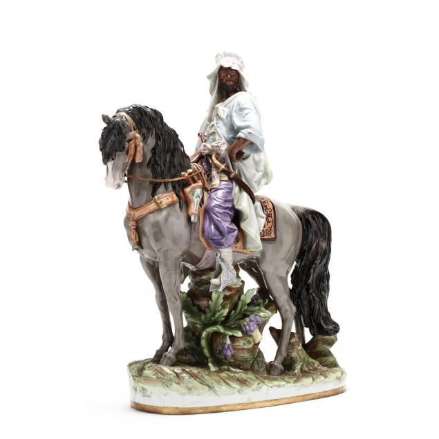 a-large-porcelain-figurine-of-an-arabian-on-horseback