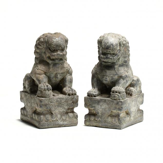 a-pair-of-asian-carved-stone-foo-dogs