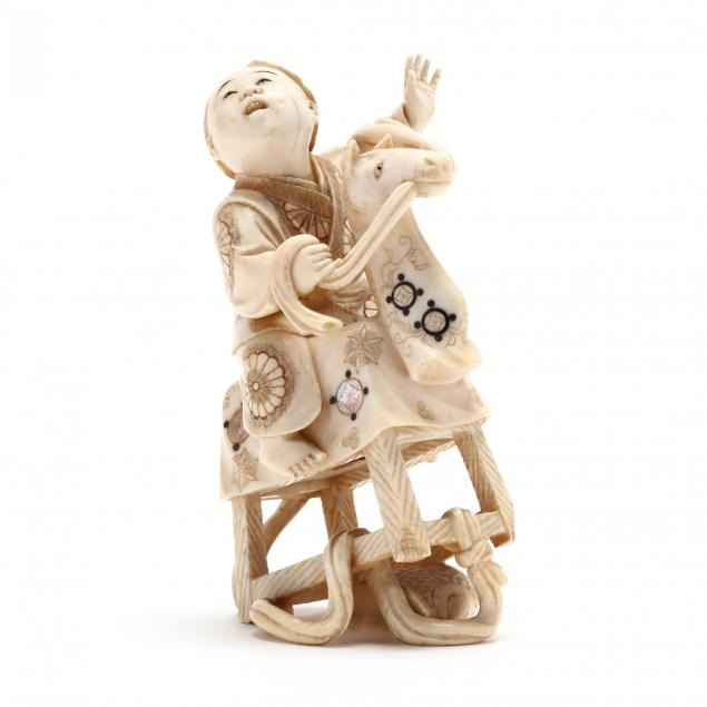 japanese-carved-and-inlaid-ivory-okimono-of-a-boy-on-a-rocking-horse