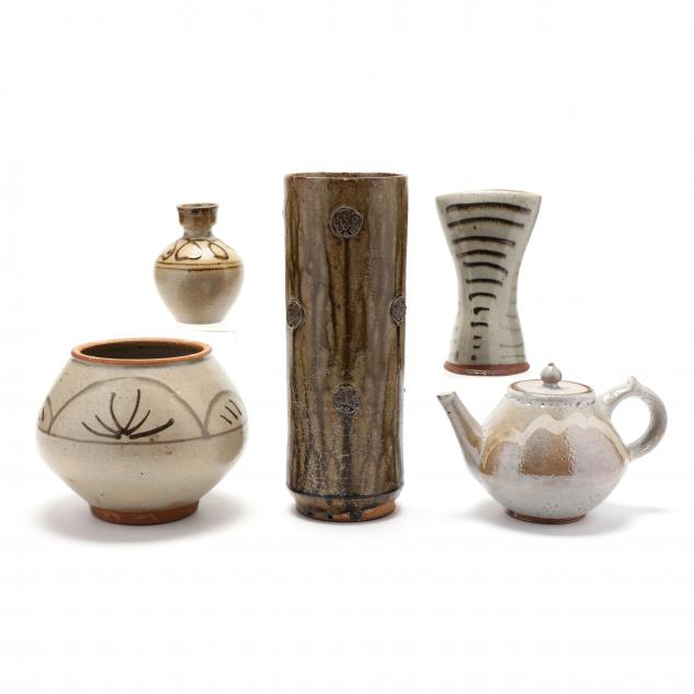 a-group-of-mark-hewitt-pottery-by-apprentices