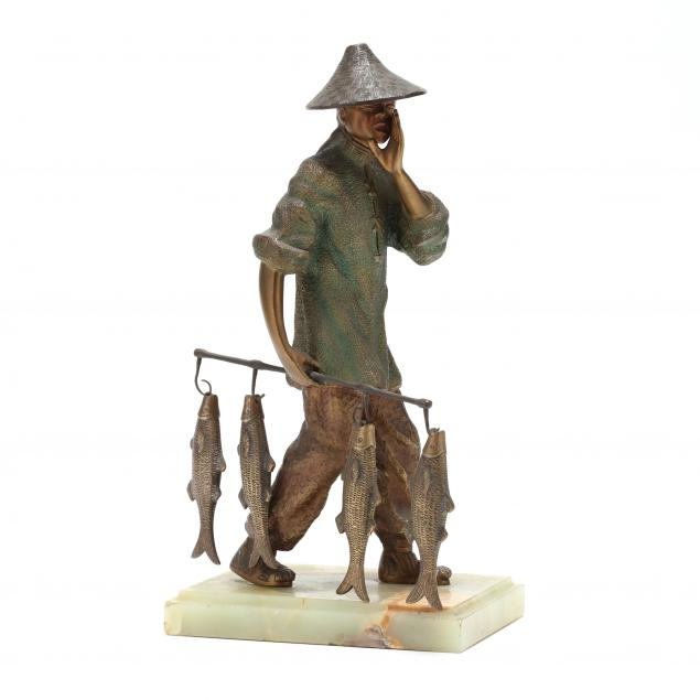 an-asian-bronze-fisher-sculpture-on-hardstone-base