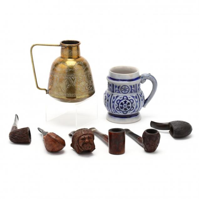 six-vintage-pipes-and-two-mugs
