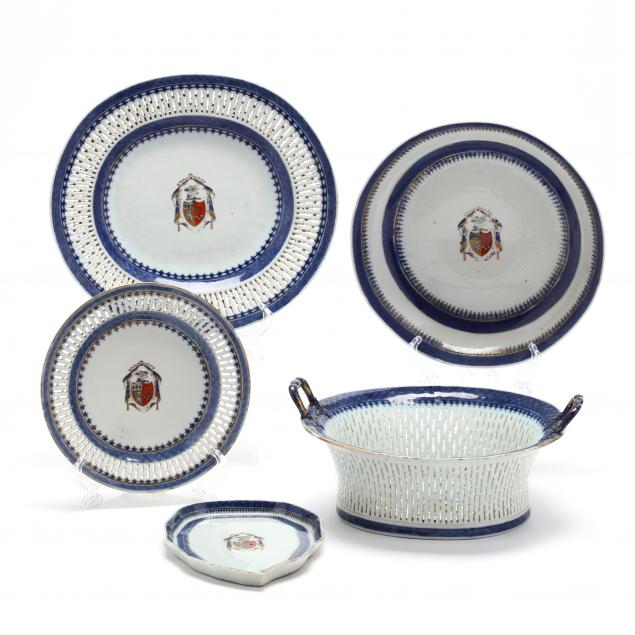 a-twenty-three-piece-chinese-export-armorial-porcelain-partial-set