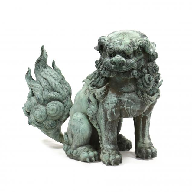 a-large-cast-and-patinated-bronze-foo-dog