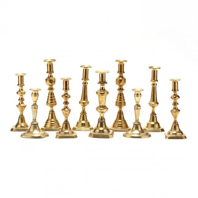 ten-antique-brass-candlesticks