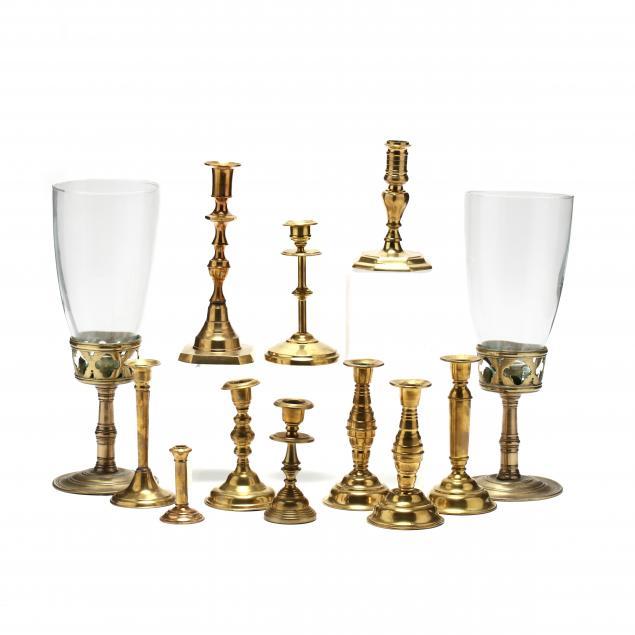 group-of-vintage-brass-candlesticks