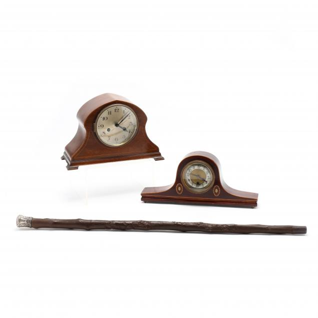 two-vintage-mantel-clocks-and-cane