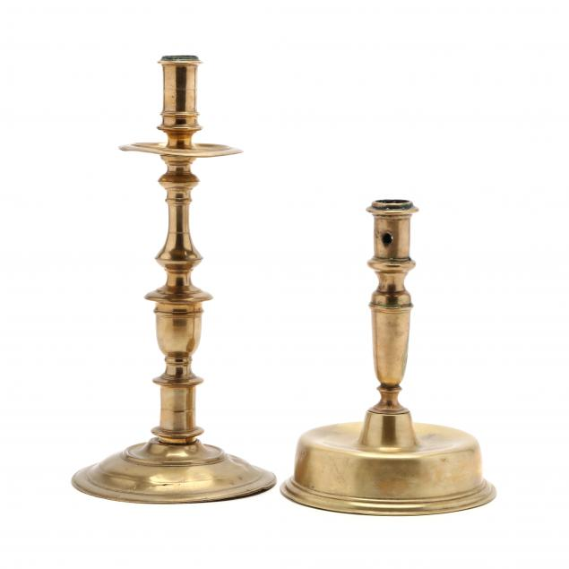 two-antique-brass-candlesticks
