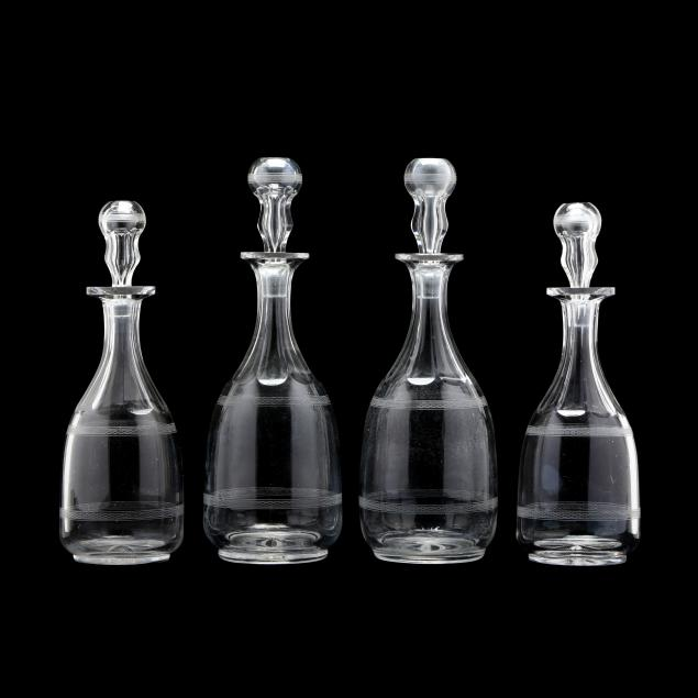 four-antique-etched-and-cut-glass-decanters
