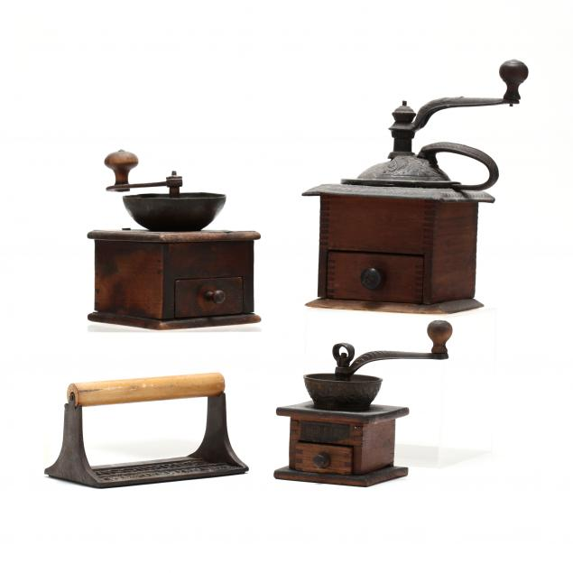 three-antique-coffee-grinders-and-a-bacon-press
