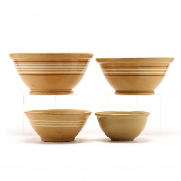 a-graduated-group-of-antique-yellow-ware-bowls