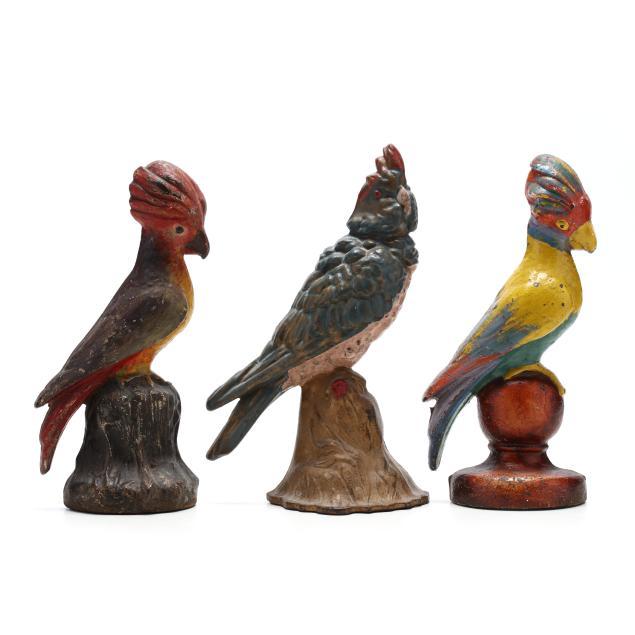three-vintage-cockatoo-doorstops