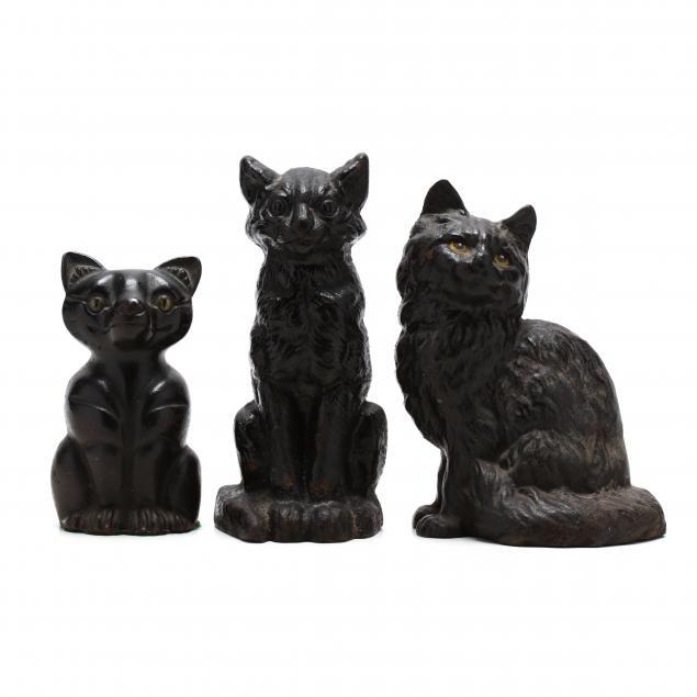 three-vintage-black-cat-doorstops