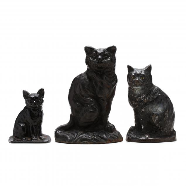 three-vintage-cast-iron-cat-doorstops