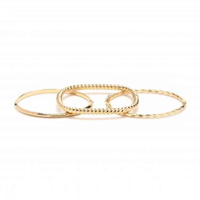three-18kt-gold-bracelets