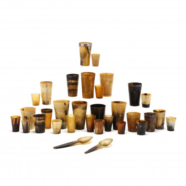 a-group-of-antique-horn-beakers-shot-cups