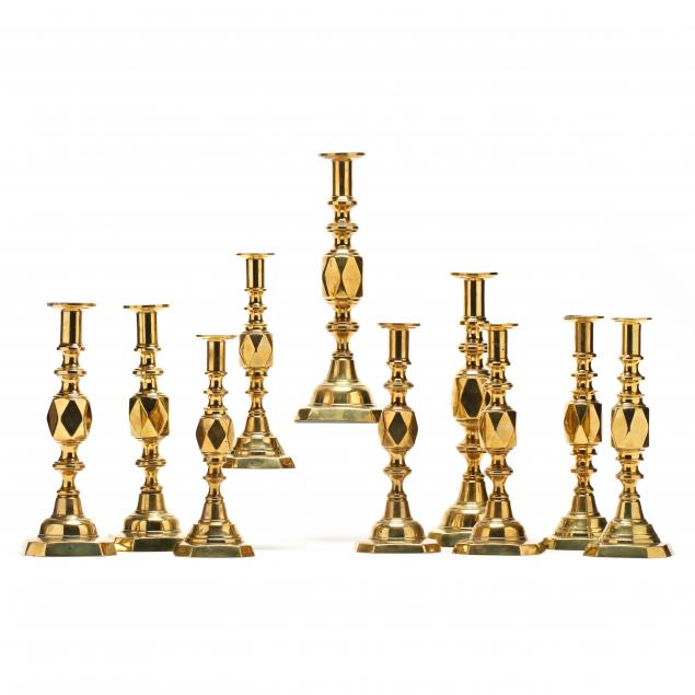 a-suite-of-antique-brass-diamond-candlesticks