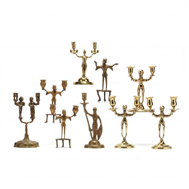 nine-antique-figural-brass-candlesticks