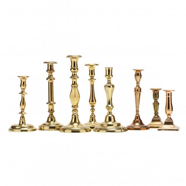 eight-antique-brass-candlesticks