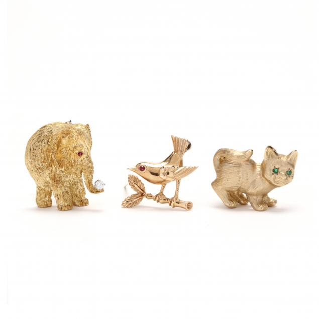 three-whimsical-gold-brooches