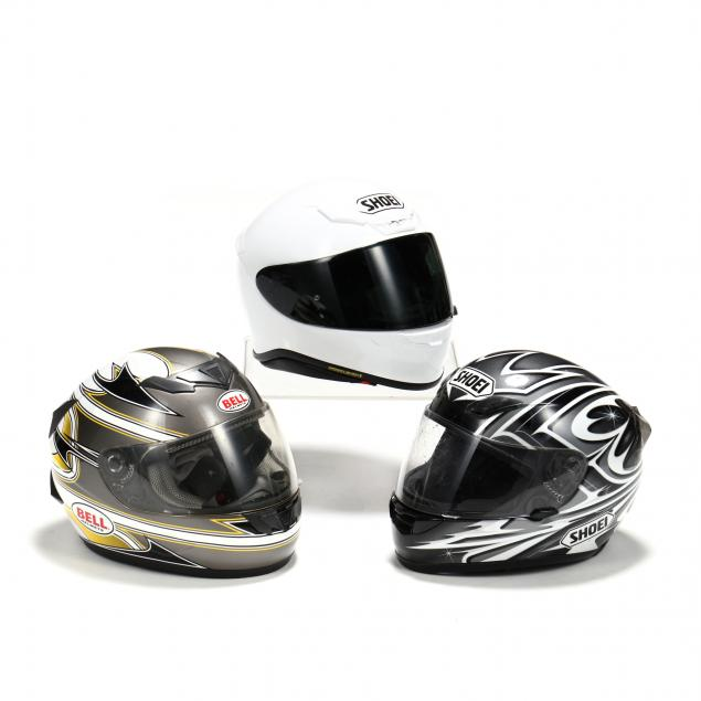three-motorcycle-helmets