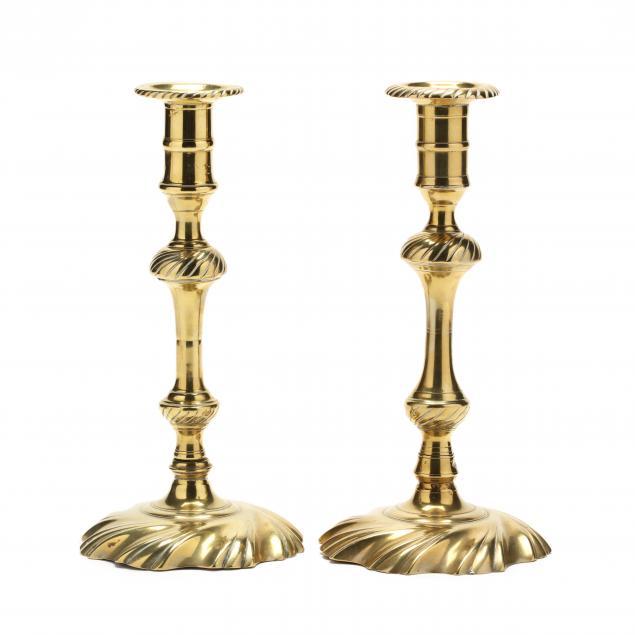 a-near-pair-of-spiral-decorated-queen-anne-brass-candlesticks