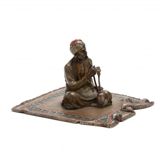 an-austrian-cold-painted-bronze-figure-of-a-seated-figure
