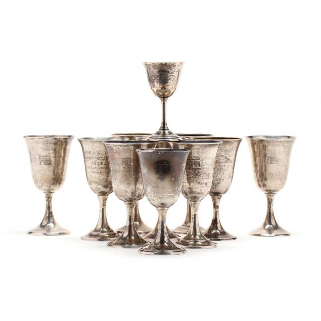 an-assembled-set-of-eleven-sterling-silver-trophy-goblets