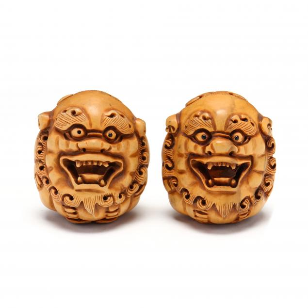 a-pair-of-carved-japanese-wood-shishi-lion-netsukes