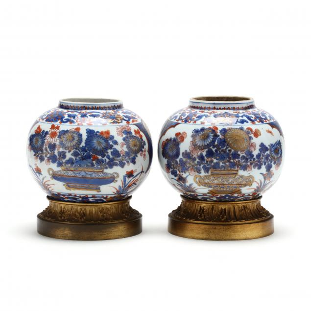 a-pair-of-chinese-imari-vases-with-gilt-ormolu-mounts