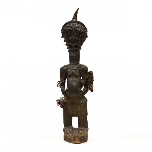 a-dosonye-ndebele-style-floor-carving-of-a-female