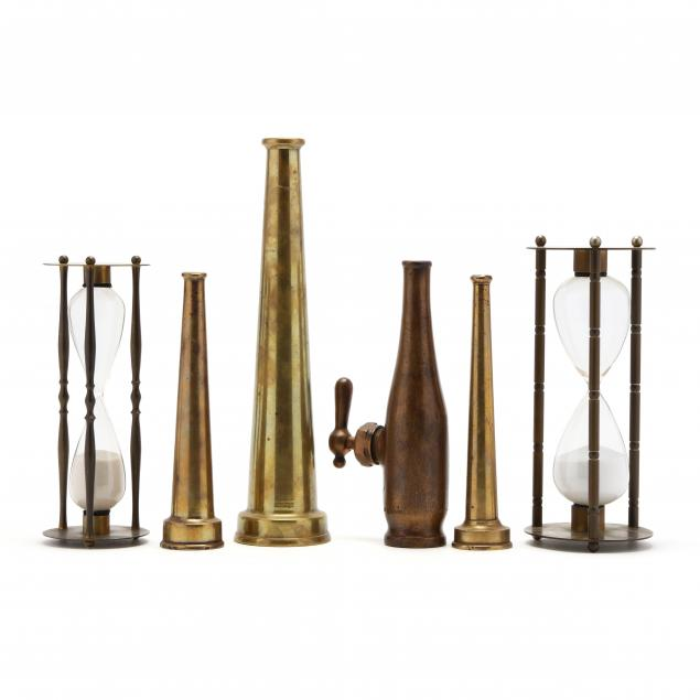 group-of-brass-fire-nozzles-and-hourglasses