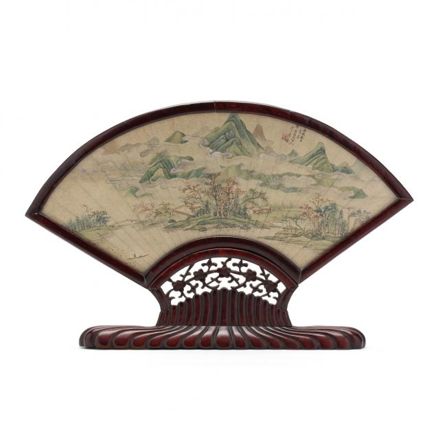 a-chinese-painted-fan-mounted-in-carved-wooden-frame