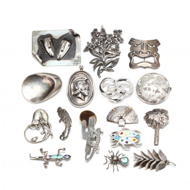 group-of-silver-brooches