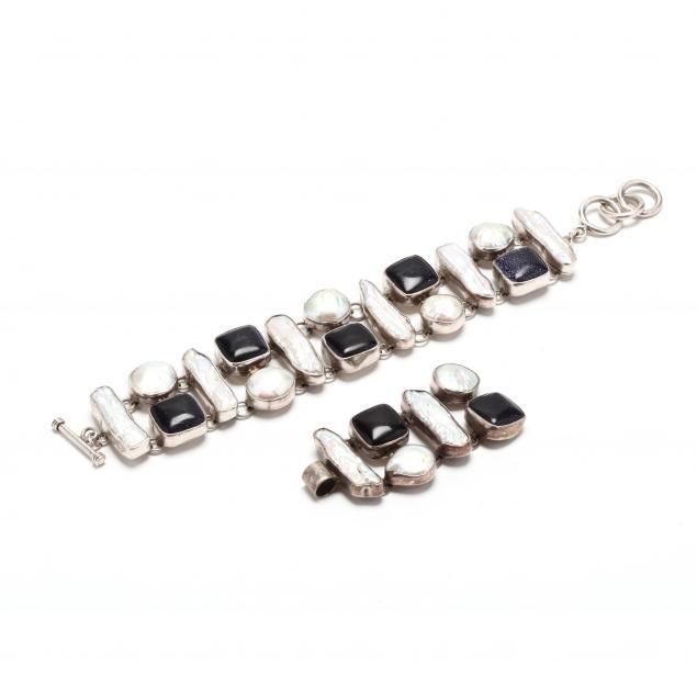a-silver-gem-set-bracelet-and-pendant