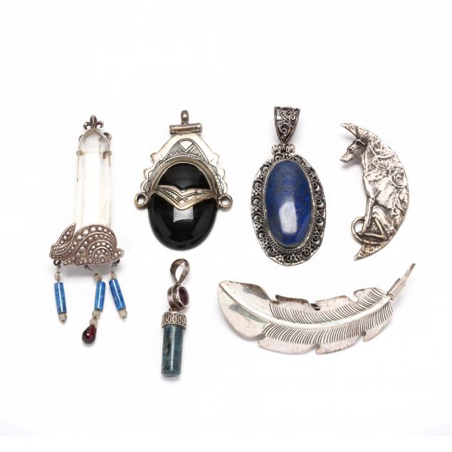group-of-silver-and-gem-set-jewelry-items