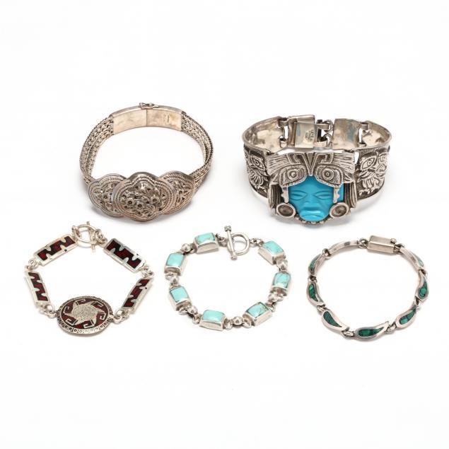 five-silver-and-gem-set-bracelets