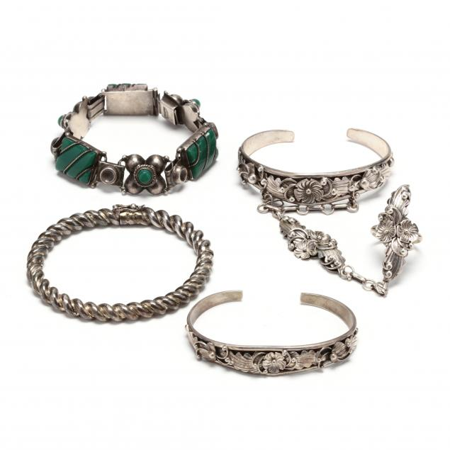 four-silver-bracelets-and-a-ring