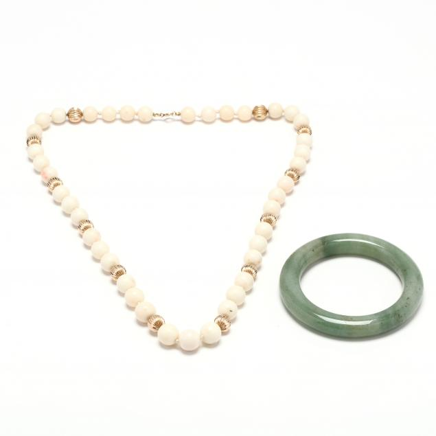 a-gold-and-coral-necklace-and-a-jade-bangle-bracelet