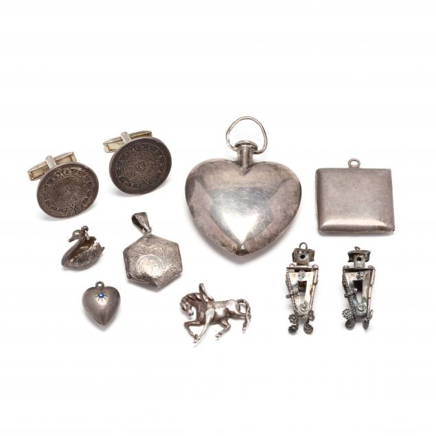 group-of-silver-pendants-and-a-pair-of-cufflinks