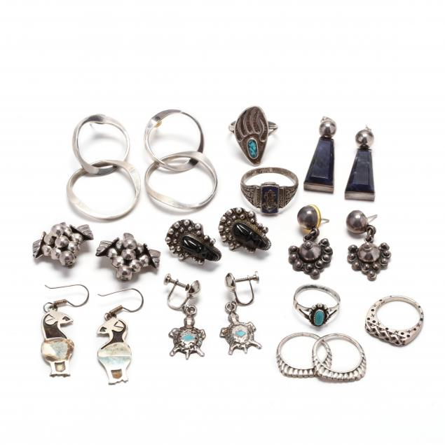 group-of-silver-earrings-and-rings