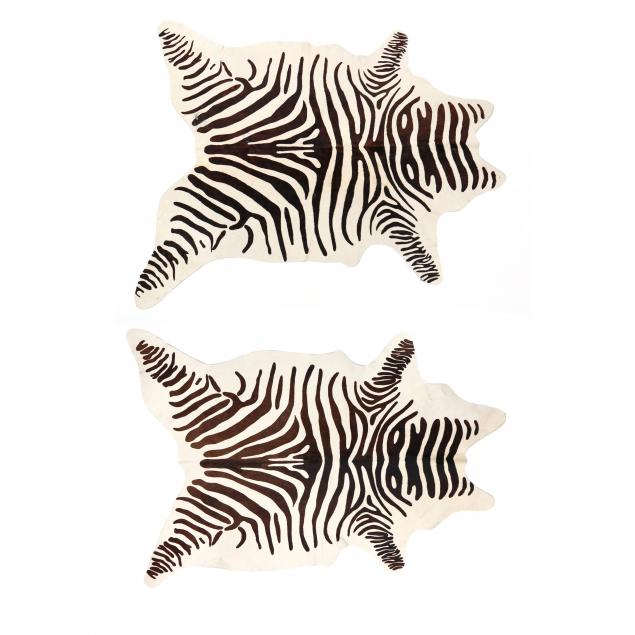 two-contemporary-faux-zebra-hide-rugs