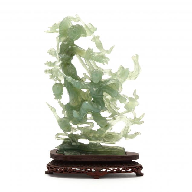 a-chinese-serpentine-jade-carving-with-stand