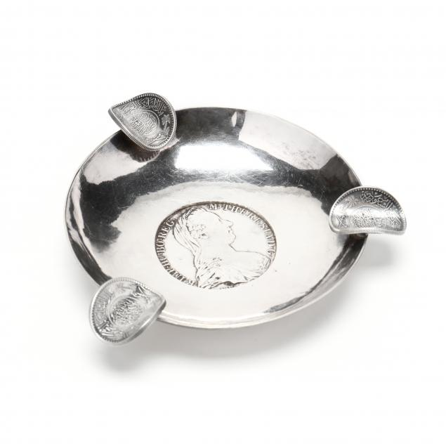 a-silver-ashtray-with-inset-coins