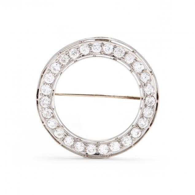 platinum-and-diamond-circle-brooch-signed