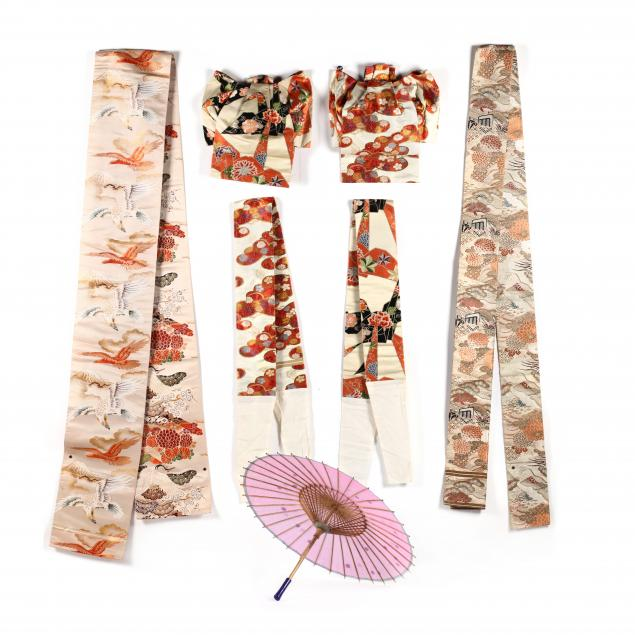 a-group-of-vintage-japanese-obis-and-silk-umbrella