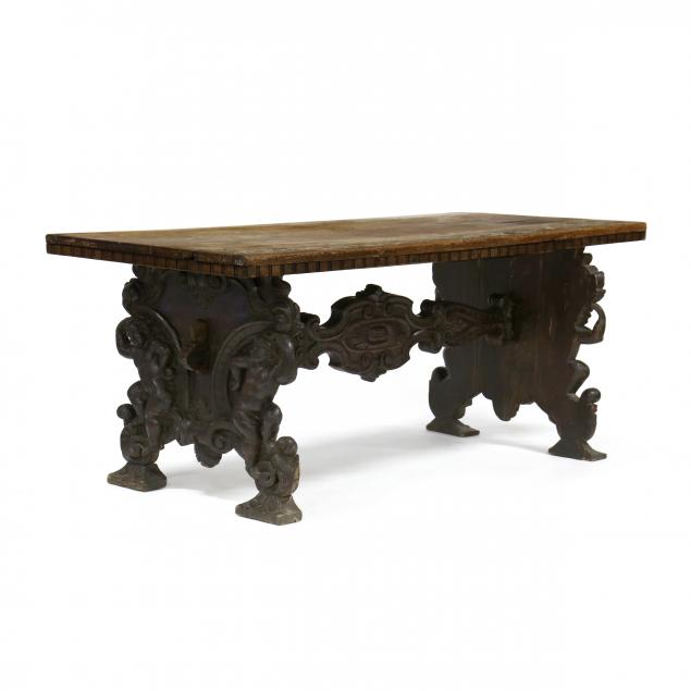 an-antique-renaissance-style-carved-walnut-dining-table