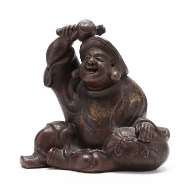 a-japanese-sculpture-of-daikokuten