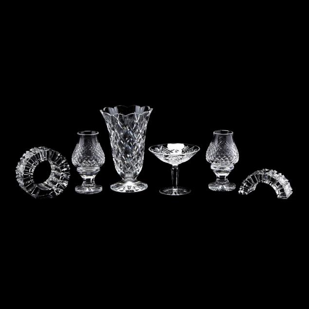 a-grouping-of-six-cut-crystal-accessories