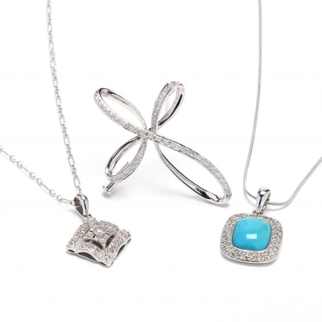 two-white-gold-and-diamond-pendant-necklaces-and-a-brooch